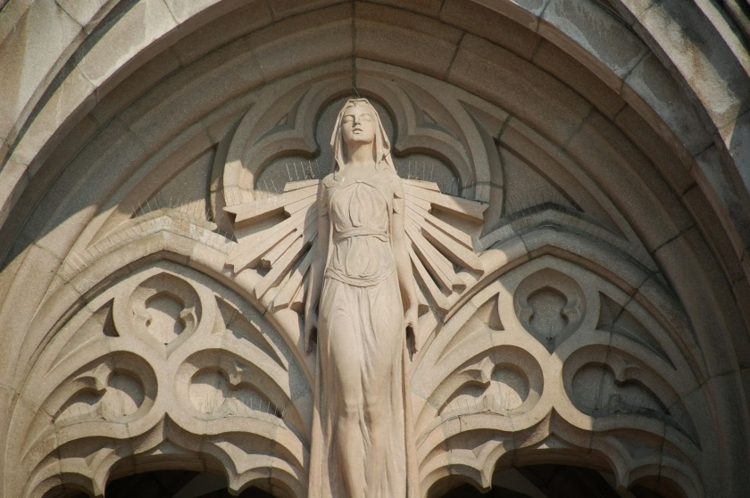 A sculpture of wisdom above the door of a cathedral. Wisdom is personified in Proverbs as a woman who calls out